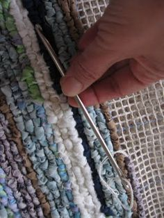 """Locker hooking. It's a craft where you take strips of fabric, """"hook"""" them through a mesh canvas, and then """"lock"""" them down by running a cotton string through the loops. There's not a lot on information on locker hooking on the web, but this site, which sells supplies, including patterns, also has a very useful tutorial that can get you started."""