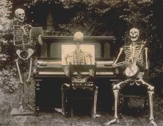 Three skeletons at the piano, via Flickr.