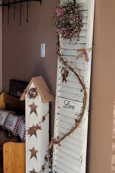 The star house my husband made and the old wooden shutter I decorated.