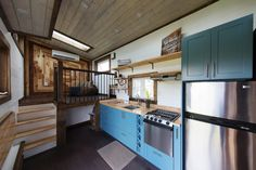 I LOVE this kitchen - Style and colors.Blue and stainless steel? YES.  Tiny House Chattanooga