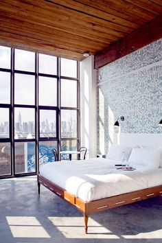 Beautiful high ceiling and wallpaper in bedroom with large windows