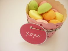 Pink and dark pink dotty cups with twine and tag