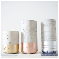 fill plastic bottle with cement, let dry, cut off, then dip in metallic paint