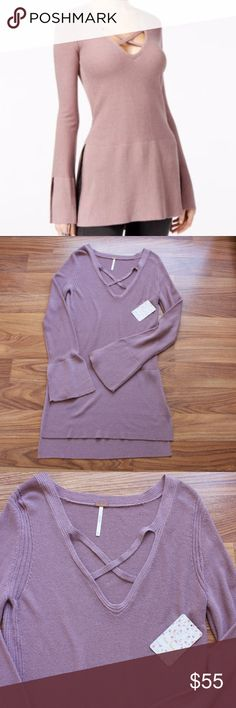 FREE PEOPLE Criss Cross Tunic Sweater Brand New! And just in time for sweater weather! How perfect would this look with dark denim jeans and ankle boots?  The color is a beautiful lavender.  Size XS but runs a little big. Could definitely fit a size SMALL person. Free People Sweaters V-Necks