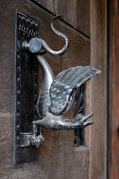 Dragon door knocker at Pownall Hall, just south of Manchester. The school was refurbished in lavish Arts & Crafts style in the 1880s by a member of the Boddington brewing family