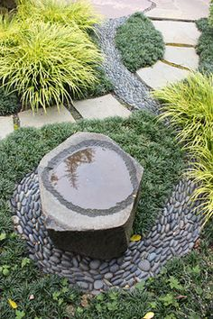 Berkeley Landscape Architects & Landscape Designers Goodman Landscape Design | pebble mosaic labyrinth leads to stone water vessel, mixed with flagstone path, Hakolechloa and succulents