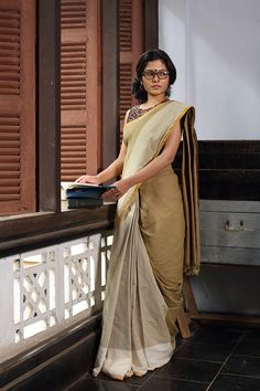 The Surrayya Saree - Seamstress Offwhite, biscuit & olive come together in this beautiful unique sari. Edged with a dull gold border it is a study in contrast. Indian Attire, Indian Wear, Indian Dresses, Indian Outfits, Simple Sarees, Plain Saree, Saree Dress, Maxi Dresses, Elegant Saree