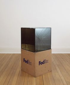FedEx® Large Kraft Box ©2005 FEDEX 330510, First Overnight, Los Angeles-London trk#798173003782, October 2-5, 2009 2009- Laminated Mirropane, FedEx shipping box, accrued FedEx tracking and shipping labels, silicone, metal, and shipping tape 24 x 24 x 24 inches