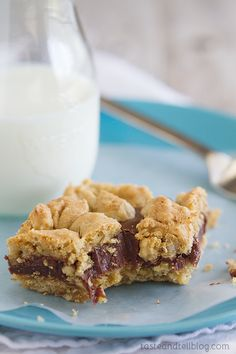 Oatmeal Fudge Bars - Gooey chocolate is sandwiched between two layers of oatmeal cookies in these decadent bars.