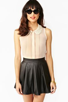 Sweet Talk Blouse. I really like the blouse, the skirt- not so much my style but it looks good on her!