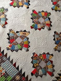 gorgeous quilting on this twirling fans quilt by sharon mcconnell, on jenny's sew kind of wonderful blog