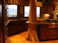 Love the tree branch in the kitchen.  Perfect for my log cabin :)