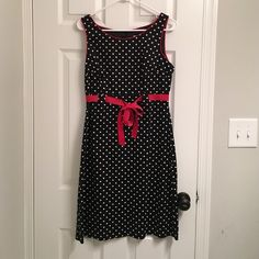 Black Polka Dot Midi Dress Super cute knee length polka-dot dress with red ribbon waist bow! Loved, but no stains, rips, or holes. Lined bodice. 97% cotton, 3% spandex, lining 100% polyester. Dress Barn Dresses Midi