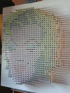 Not sure where this goes...into sculptures or paintings ! I guess it depends whether you're looking front on or side view. 1045 syringes on marine wood ply.