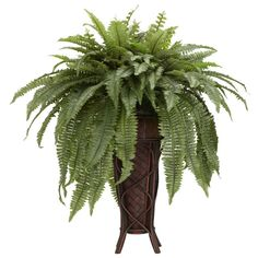 Boston Fern w/ Stand Silk Plant   Nearly Natural   The Boston Fern… a traditional houseplant for many homes and offices! And looking at this offering, you can see why so many have fallen in love with its beauty. Set in an elegantly designed tall vase, our 40 inch high Boston Fern overflows with long emerald leaves spilling out in a cascade of greenery. While the top's cut shorter to allow the upper fern to reach upward resulting in a unique two layered design.