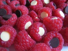 isnt this the best simplest idea ever? Chocolate and White chocolate chips inside raspberries, or stuff mini-marshmallows in too