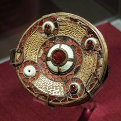 Filigree and garnet brooch, Anglo-Saxon gilded bronze, found in a cemetery in Sarre in Kent. It is currently on loan from the British Museum to the Sutton Hoo Museum in Suffolk.