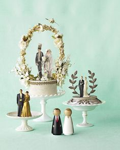 Brides and Grooms  A throwback topper like this one suits the vintage-loving bride. Find similarly snazzy duos at Fancy Flours, a great online resource for vintage toppers.