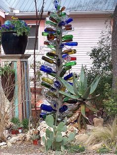 make a bottle tree for the front yard. i want a bird feeder on top and a zen garden around the bottom. would love to find a way to get a bench around there, too.