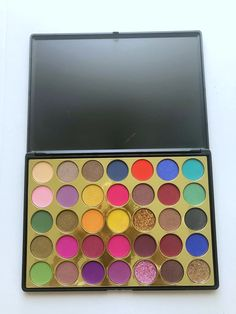 Spring inspired palette with shimmers, mattes and glitter to create colorful Spring and Summer Looks. South African Shop, Dream Doll, Cosmetic Companies, Summer Looks, Palette, Eyeshadow, Shops, Glitter, Colorful