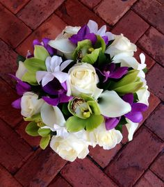 Romantic tropical bridal bouquet by @loveinbloomkw Love In Bloom Florist, wedding flowers, green and purple, roses and orchids