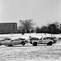 USA New York State Long Island Tow truck pulling wracked car in winter scenery Canvas Art - (24 x 36)