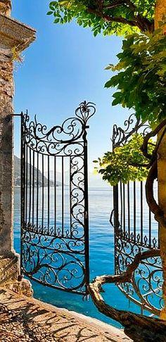 Wonderful Wrought Iron Gate Leading To A Lake.............