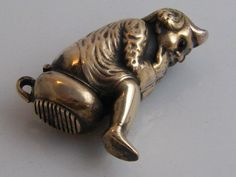 1 of 7: NOVELTY BRASS VESTA CASE IN FORM OF A BOY ON POTTY