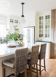 All-white kitchen with textural elements {PHOTO: Tracey Ayton}