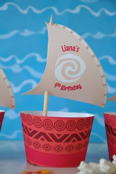 THE OCEAN IS CALLING!  This PDF printable cupcake wrapper and topper set will add a splash of ocean adventure to your Polynesian themed party! The topper sails will be personalised for you with the name and age of the birthday girl or boy. Simply download the pdf file which will be sent to your email address, open and print with Adobe Reader, then cut out and assemble for original favor ideas for your Polynesian themed party! The cupcake wrapper prints 2 per letter size or A4 page, and the…