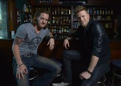"""""""Hey girl, can we buy you a drink?"""" Florida Georgia Line's Tyler Hubbard and Brian Kelley hang out before their performance at the Troubadour on Nov. 25 in Los Angeles"""