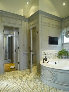 do paneling in bath tub surround- faux transom/mirror over doorway- tall moulding around top to make grander- paint and glaze for aged looked- OMG!!! gorgeous!