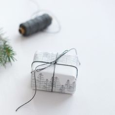 pine tree wrapping | grey pencil on white paper | blue string | Paper design by Jurianne Matter