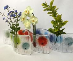 These fused art glass vases are a lovely accessory for your home, and they make a unique gift. Two layers of art glass are fused together leaving a pocket for t
