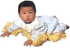 "This handy pre-toddler mop garment was ""invented"" by Kenji Kawakami, a Japanese inventor and writer who works in a parallel innovation universe he calls Chindogu. Description from ideachampions.com. I searched for this on bing.com/images"