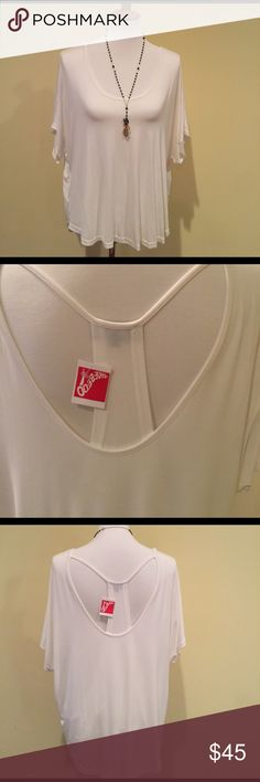 """Off white high low top with interesting back Off White top from a Shoe-Be- Do boutique store. Never worn. Has original tag.                            Back drops about 27"""", front drops about 25"""".   Scoop neckline, short sleeves, Back has an halter type layer.  Cotton, poly, spandex blend. Shirt runs big. I usually wear a large but this is a small. P.O.L. Tops Tunics"""
