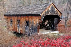:The 37-foot-long Baltimore Covered Bridge—a lattice truss design patented by architect Ithiel Town—was built in 1870 by Granville Leland and Dennis Allen over the Great Brook in North Springfield, Vermont. The bridge was moved in 1970 to its current site adjacent to the town's historic Eureka Schoolhouse.