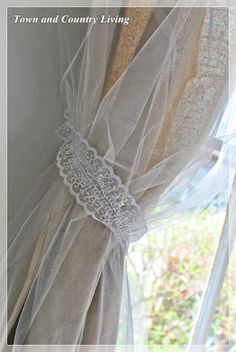 Dropcloth curtain covered with tulle and tied with lace