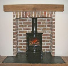 Refurbished original 1920's brick chamber and arch with new oak beam, natural slate tiled hearth and gloss black enamelled Aga Little Wenloc...