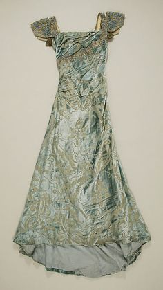 Dress, Evening  Date: 1910–14 Culture: European (probably) Medium: silk, metal, paste Dimensions: Length at CB: 62 1/2 in. (158.8 cm)