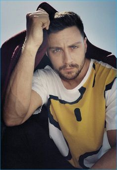 Aaron Taylor-Johnson sports a Lanvin coat with a Gucci Woodstock t-shirt.