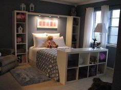 expedit shelving around bed. i like the shelf at the end of the bed.