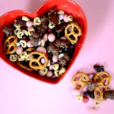 Valentine's Day Trail Mix     4 cups miniature pretzels   4 cups Quaker heart shaped cereal (or favorite cereal)   3 cups (1 box) Chocolate Teddy Grahams   2 cups dried cherries or cranberries   2 cups yogurt covered raisins   2 cups Valentine M     Dump all the ingredients in a large bowl and mix. Use a 1/2 cup scoop to pour into snack-size zip bags.