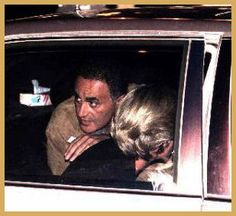 Last photo taken. Dodi Al Fayed looks over Princess Diana's shoulder as the Mercedes is pulling away from The Ritz hotel in Paris on August 31, 1997. Minutes later,as we all know....is history.
