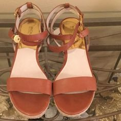 MICHAEL KORS Ankle Strap Wedges Leather upper with decorative logo charm at l.Adjustable ankle strap with buckle closure Leather lining; lightly padded footbed Approx. 2 3/4 inch wedge and 1 1/2 platform. Worn once in excellent condition. Michael Kors Shoes Sandals