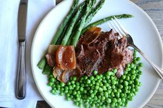 Slow-Cooker Pot Roast with Peas and Asparagus: Your crock pot does the work and you get credit for all the amazing flavor.  Get the recipe from Delish.