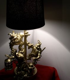 RED BIRD: A Golden Toy Lamp Made From Action Figures