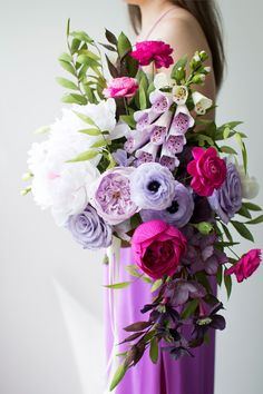 Purple and pink crepe paper bouquet with peonies, ranunculus, roses, garden roses, foxglove, hellebores, and hydrangea by Jessie of Crafted to Bloom.
