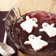 Creamy ghost ice cubes are a festive addition to this Halloween Punch. Recipe: http://www.bhg.com/recipe/drinks/ghost-punch/