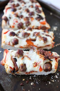 Easy French Bread Pizza Recipe on twopeasandtheirpod.com. This pizza only takes 20 minutes to make!